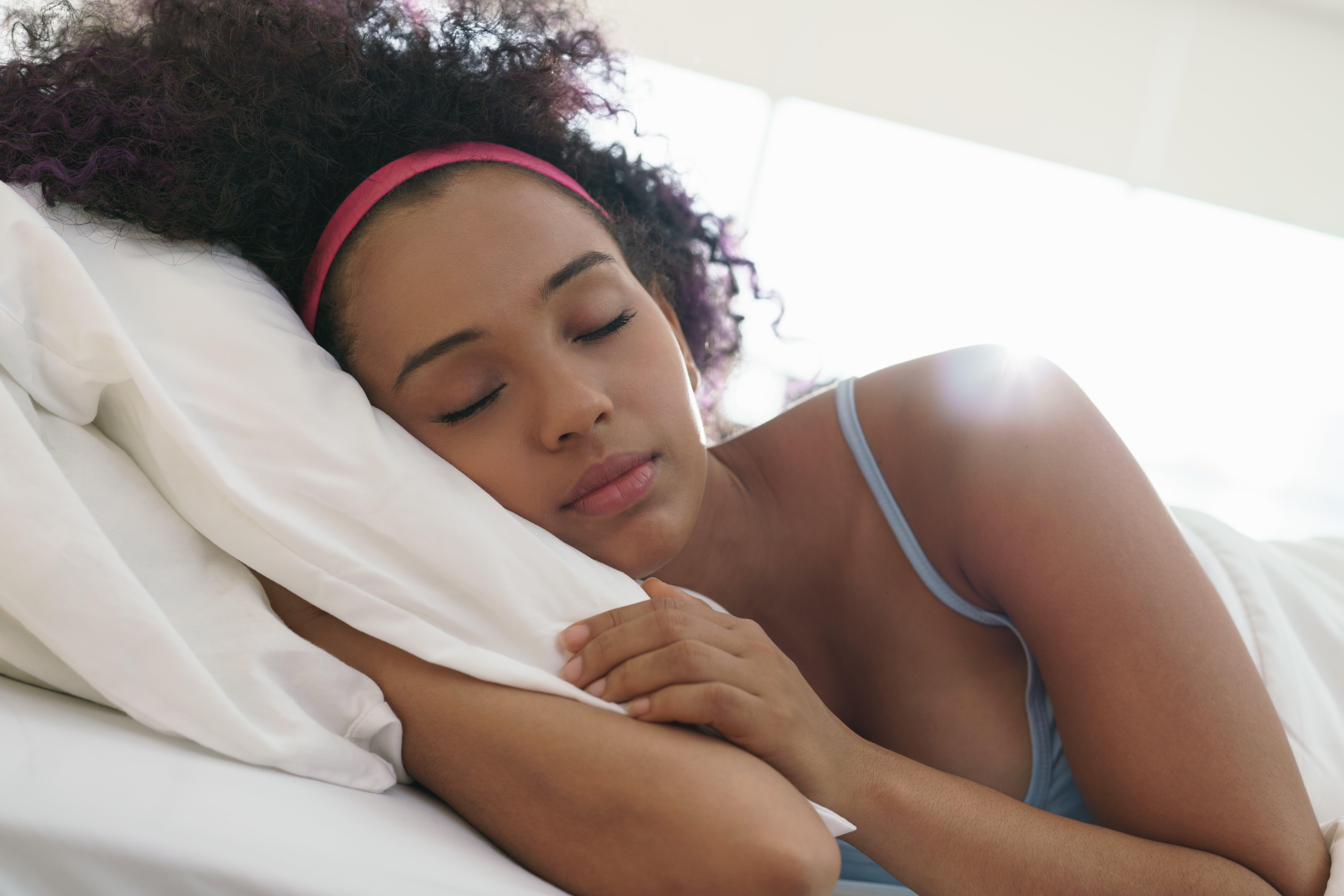 Canva - Portrait of Beautiful Happy Black Girl Waking up Slow Motion